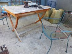 A TEAK GARDEN TABLE AND TWO WROUGHT IRON CHAIRS (3).