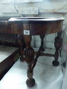 AN OVAL OCCASIONAL TABLE