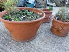A PAIR OF SMALL TERRACOTTA PLANTERS AND ONE LARGE PLANTER (3).