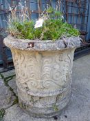 A LARGE RELIEF DECORATED CIRCULAR PLANTER.