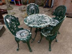 A SET OF FOUR CAST METAL PATIO CHAIRS AND A SIMILAR TABLE.