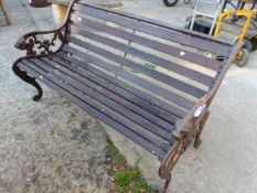 A GARDEN BENCH WITH CAST IRON ENDS.