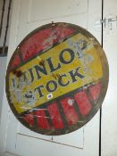A DUNLOP DOUBLE SIDED ADVERTISING SIGN