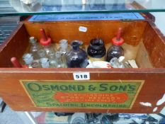 AN OSMONDS OF SPALDING MEDICINE CHEST WITH A SELECTION OF BOTTLES AND A RED CROSS FEEDER