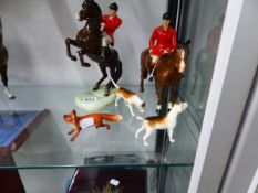 TWO BESWICK HUNTSMEN, TWO HOUNDS AND THE FOX