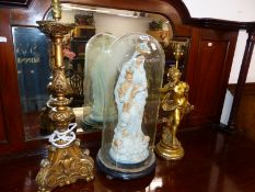 A PLASTER MADONNA AND CHILD UNDER A GLASS DOME TOGETHER WITH A GILT FIGURAL TABLE LAMP AND A BAROQUE