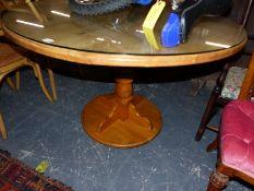 A MODERN OAK BREAKFAST TABLE