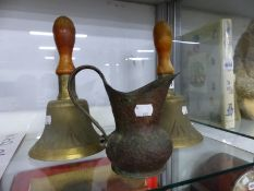 TWO WAR DEPARTMENT HAND BELLS TOGETHER WITH A TRENCH ART JUG