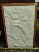 AM IMPRESSIVE ARTS AND CRAFTS CAST PLAQUE MARCH HARES INSCRIBED FJP IN A SHAPED OAK FRAME.