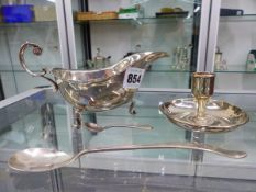 A HALLMARKED SILVER SAUCEBOAT, TWO SMALL CONDIMENT SPOONS AND A TIFFANY SILVER PLATED TAPER