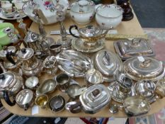 A COLLECTION OF ELECTROPLATE TEA WARES, CANDLESTICKS AND VEGETABLE TUREENS