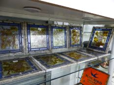 TEN LEADED GLASS PANELS PAINTED WITH FRUIT AND FOLIAGE, EACH 23 x 19cms.