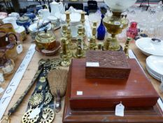 BRASS CANDLESTICKS, STRAPS OF HORSE BRASSES, CUTLERY BOXES AND AN OIL LAMP