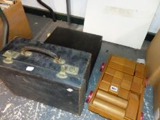 A FOUR DRAWER SUIT CASE, CASED IMPIAL TYPEWRITER AND A PULL ALONG CART OF WOODEN BRICKS