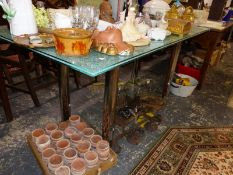 A VINTAGE/RETRO PLATE GLASS DINING TABLE