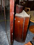 A GEORGE III OAK BOWFRONT CORNER CABINET, A MAHOGANY TEA CADDY AND A LARGE MIRROR (3)