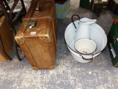A SUITCASE, TWO ENAMELLED BOWLS AND A JUG
