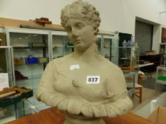 AN ANTIQUE STYLE COMPOSITION STONE BUST.