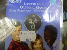 A RARE BLUE PETER 50P WINNERS EDITION, FIFTY PENCE COIN, MINTED IN 2009, DATED 2012 OLYMPIC GAMES.