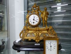 A GILT METAL AND ALABASTER MANTEL CLOCK TOGETHER WITH A CARRIAGE TIMEPIECE