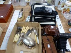 CAMERAS, PRINTS, A SILVER BUTTER KNIFE, ELECTROPLATE CUTLERY AND A PAIR OF MOTHER OF PEARL BACKED