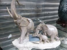 A LLADRO PORCELAIN FAMILY OF THREE ELEPHANTS