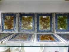 TEN LEADED GLASS PANELS OF FRUIT AND FLOWERS, EACH. 23 x 18.5cms.
