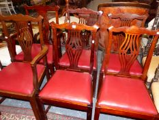 A SET OF SIX MAHOGANY DINING CHAIRS INCLUDING TWO ARMCHAIRS (6)