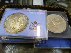 AN AMERICAN EAGLE SILVER DOLLAR, WORLD BANK NOTES AND MIXED WORLD AND GB COINS.