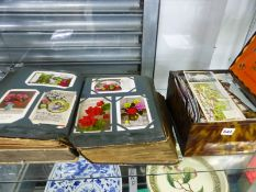 FOUR ALBUMS AND A TIN BOX OF POST CARDS