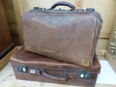 A GLADSTONE BAG AND A LEATHER SUITCASE.