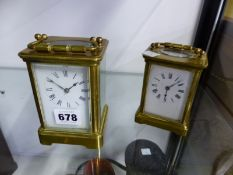 A CARRIAGE CLOCK STRIKING ON A COILED ROD TOGETHER WITH A CARRIAGE TIMEPIECE