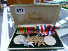 FIVE WWII MILITARY MEDALS AND AN RAF BADGE.