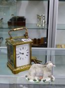 AN ANTIQUE STRIKING CARRIAGE CLOCK WITH KEY, TOGETHER WITH A SHEEP FIGURE.