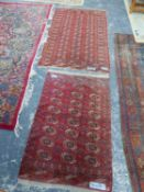 TWO TEKKE BOKHARA RUGS, 192 x 113cms AND 144 x 91cms (2)