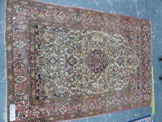 AN ANTIQUE PERSIAN ISFAHAN RUG, 210 x 145cms