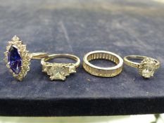 FOUR SILVER AND CUBIC ZIRCONIA DRESS RINGS