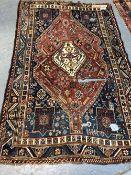 AN ANTIQUE PERSIAN SHIRAZ RUG (LOSSES), 219 x 141cms