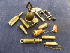 A QUANTITY OF BRASS SEWING ACCOUTREMENTS, WHISTLES, A STAMP PRESS ETC
