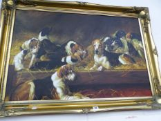 A DECORATIVE SWEPT GILT FRAMED PICTURE OF DOGS. SIGNED INDISTINCTLY. 60 x 90cms