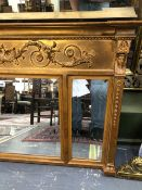 A REGENCY STYLE GILT OVER MANTLE MIRROR.