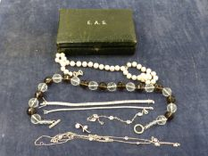 A SILVER AND CUBIC ZIRCONIA LINE BRACELET, TOGETHER WITH A 9ct GOLD CUBIC ZIRCONIA LINE BRACELET,