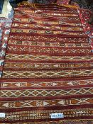 A TRIBAL FLATWEAVE RUG, PROBABLY NORTH AFRICAN, 227 x 148cms