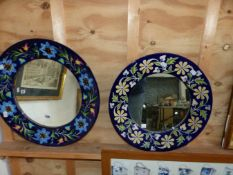TWO DECORATIVE POLYCHROME POTTERY CIRCULAR MIRRORS. LARGEST D. 48cms (2)