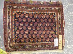 AN ANTIQUE PERSIAN TRIBAL BAG FACE, 74 x 65cms