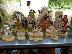 A LARGE QUANTITY OF STAFFORDSHIRE FLAT BACK FIGURINE GROUPS