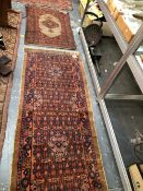 TWO ANTIQUE PERSIAN SERAB RUGS (ALTERED), LARGEST 250 x 86cms (2)