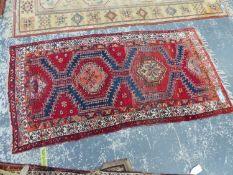 A PERSIAN TRIBAL RUG, 225 x 116cms