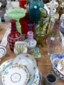 A COLLECTION OF VINTAGE ART GLASS DECANTERS, LAMPS, VASES, ETC
