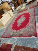 A PERSIAN KIRMAN CARPET, 453 x 295cms